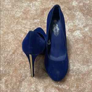 Navy blue heels with gold embellishment